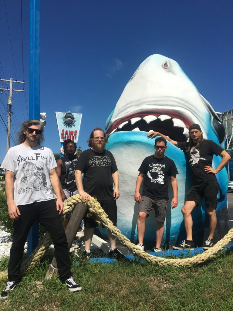 Humungus group photo with shark